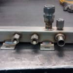 cooling manifold, was leak tested and passivated following welding